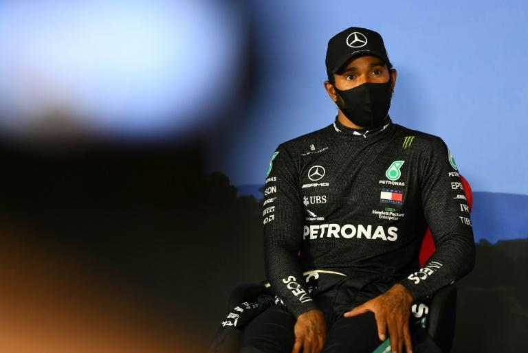 'Generally complicit': Lewis Hamilton attends a press conference after qualifying (AFP Photo/Mario RENZI)