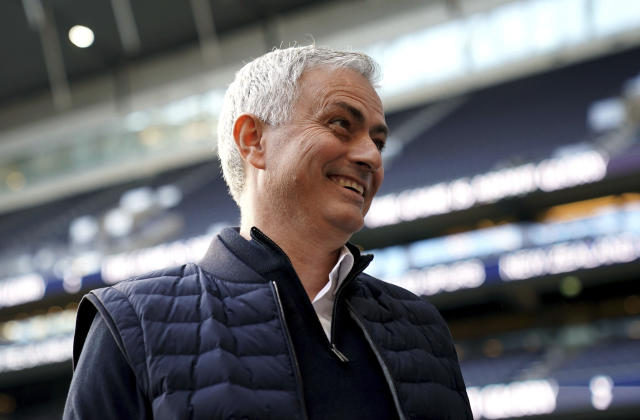 Tottenham Hotspur manager Jose Mourinho smiles before their English Premier League match against AFC Bournemouth at Tottenham Hotspur Stadium, London, Saturday, Nov. 30, 2019. (John Walton/PA via AP)