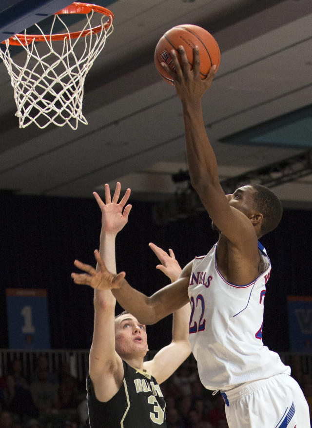 Kansas' Andrew Wiggins, right, goes up for a layup against Wake Forrest's Tyle Cavanaugh during an NCAA college basketball game in Paradise Island, Bahamas, Thursday, Nov. 28, 2013. Kansas won 87-78. (AP Photo/Bahamas Visual Services, Dante Carrer)
