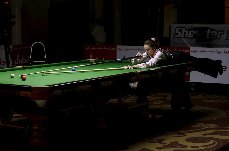 Latvia's Tatjana Vasiljeva plays a shot during her snooker match against India's Amee Kamani during the IBSF World 6 Red Snooker Championships in Karachi, Pakistan, August 8, 2015. REUTERS/Akhtar Soomro