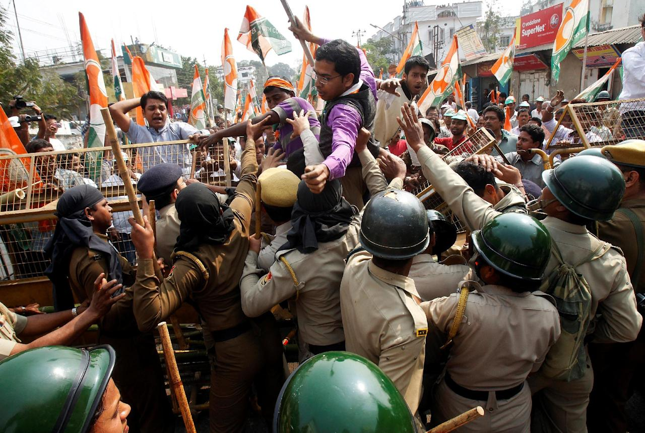Demonstrators try to cross a police barricade during a protest organized by India's main opposition Congress party  against demonetisation, according to the party organizers, in Agartala, India, February 17, 2017. REUTERS/Jayanta Dey     TPX IMAGES OF THE DAY