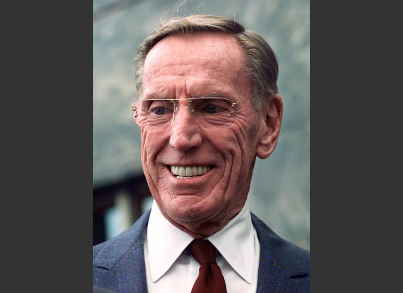 FILE - In this April 6, 1999, file photo, former Lincoln Savings & Loan chief Charles Keating Jr. smiles during a news conference at the Los Angeles Federal Courthouse. Keating, the financier who was disgraced for his role in the costliest savings and loan failure of the 1980s, has died. He was 90. A person with direct knowledge of the death confirmed that Keating died but didn't provide further details. The person wasn't authorized to release the information and spoke on condition of anonymity. (AP Photo/Nick Ut, File)