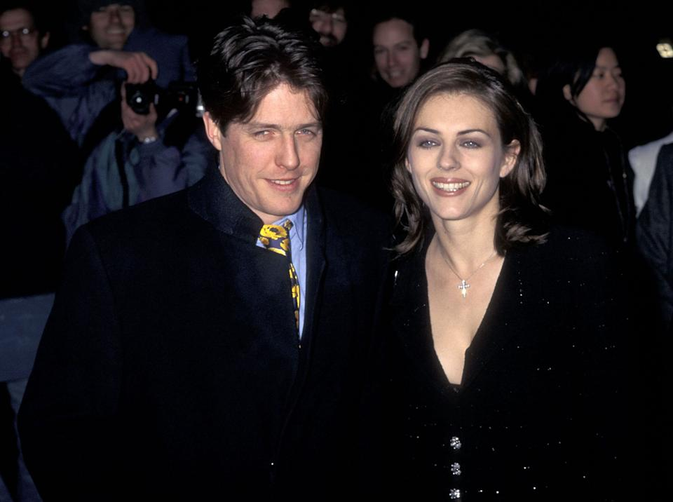 """Actor Hugh Grant and actress Elizabeth Hurley attend the """"Restoration"""" New York City Premiere on December 10, 1995 at the Ziegfeld Theater in New York City. (Photo by Ron Galella, Ltd./Ron Galella Collection via Getty Images)"""