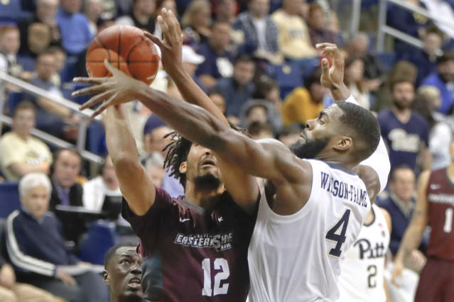 Maryland Eastern Shore's AJ Cheeseman (12) tries to shoot as Pittsburgh's Jared Wilson-Frame (4) defends during the second half of an NCAA college basketball game, Saturday, Dec. 15, 2018, in Pittsburgh. Pittsburgh won 78-43.(AP Photo/Keith Srakocic)