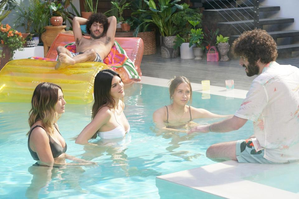 """Rapper Dave (Dave Burd), right, talks to Hailey Bieber, from left in the pool, Kendall Jenner and Elsie Hewitt, as Dave's friend and record producer Benny Blanco looks on in a scene from FXX's """"Dave."""""""