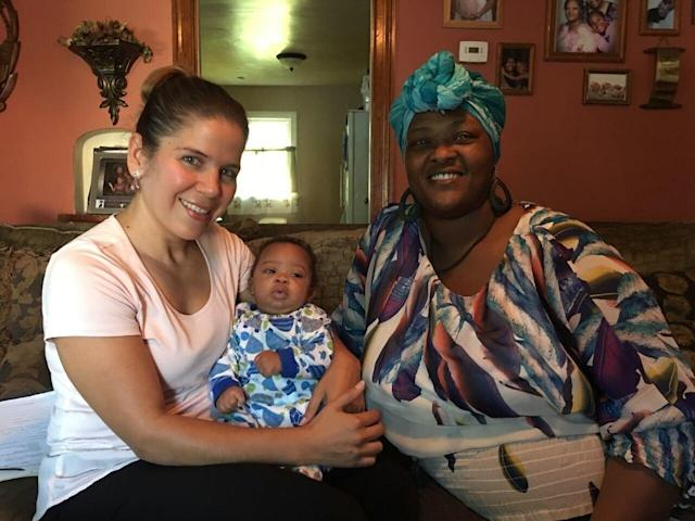 Jackie Martinez (left) holding the baby of Nikki Miltons, who she helped at Healthier Moms and Babies in Fort Wayne, Indiana.