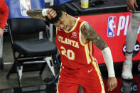 Atlanta Hawks forward John Collins (20) reacts after making a three pointer to put the Hawks ahead of Washington Wizards during the second half of an NBA basketball game Wednesday, May 12, 2021, in Atlanta. Atlanta Hawks defeated the Washington Wizards 120-116. (AP Photo/Butch Dill)