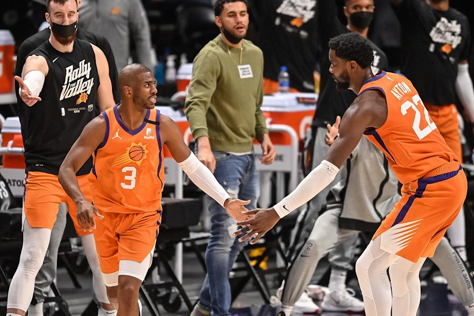 Chris Paul #3 of the Phoenix Suns is congratulated by Deandre Ayton #22 after a basket in Game Three of the Western Conference second-round playoff series at Ball Arena on June 11, 2021 in Denver, Colorado. NOTE TO USER: User expressly acknowledges and agrees that, by downloading and or using this photograph, User is consenting to the terms and conditions of the Getty Images License Agreement. (Photo by Dustin Bradford/Getty Images)