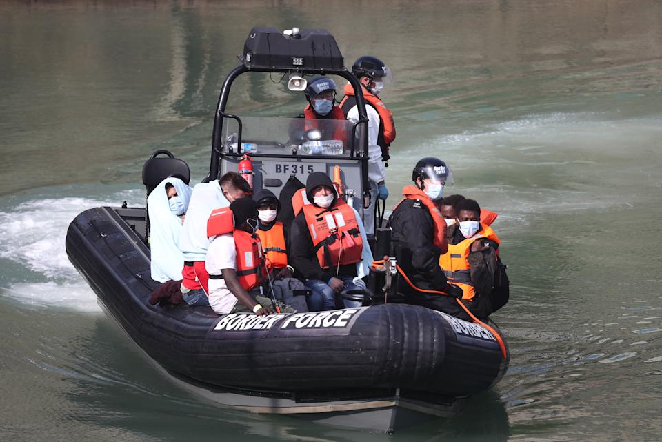 A group of people, thought to be migrants, on a Border Force rib at Dover last year. (PA)