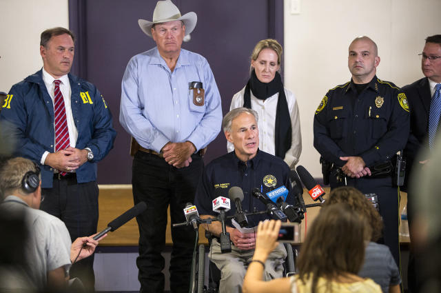 <p>Texas Gov. Greg Abbott, seated right, addresses members of the media about the mass shooting at the First Baptist Church in Sutherland Springs, Texas, during a press conference in Stockdale, Texas, on Nov. 5, 2017. (Nick Wagner/Austin American-Statesman via AP) </p>
