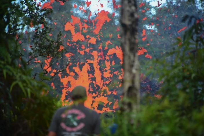 Lava spits from a fissure in the Leilani Estates subdivision on Hawaii's Big Island after earthquakes prompted the Kilauea volcano to erupt (AFP Photo/FREDERIC J. BROWN)