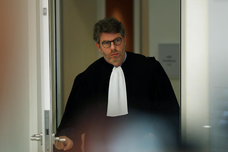 Lawyer of Saudi Princess Hassa bint Salman, Emmanuel Moyne, leaves the courthouse in Paris, Thursday, Sept. 12, 2019. The only daughter of Saudi Arabia's King Salman has been found guilty by a Paris court of charges that she ordered her bodyguard to detain and strike a plumber for taking photos at the Saudi royal family's apartment in the French capital. (AP Photo/Thibault Camus)