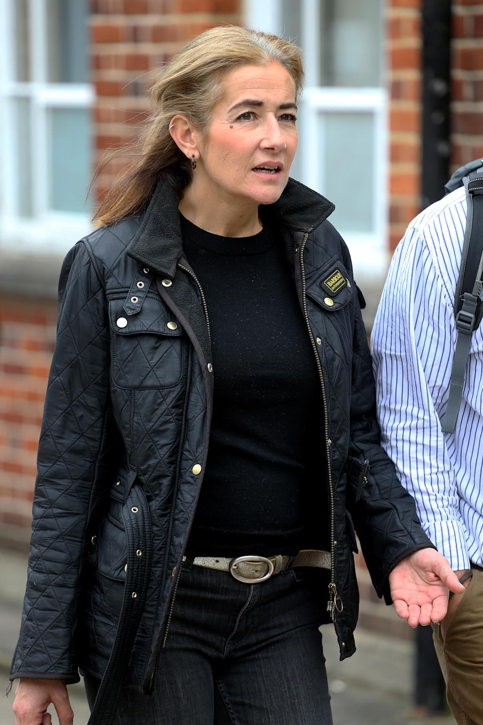 Emma Langford, 47, leaves Uxbridge Magistrates Court, after appearing accused of drunkenly assaulting three people aboard a British Airways flight.