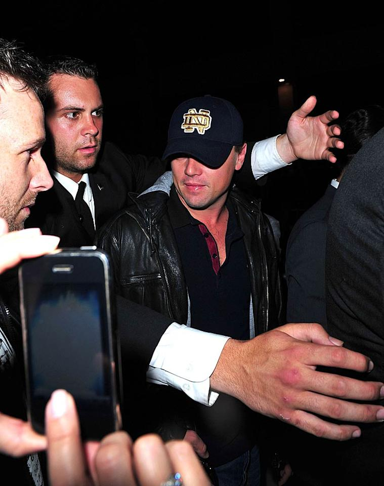"""Leonardo DiCaprio's bodyguard kept him at arm's length from a fan trying to snap a cellphone photo Wednesday night at the grand opening of Dream Downtown, a new hotel project in NYC. James Devaney/<a href=""""http://www.wireimage.com"""" target=""""new"""">WireImage.com</a> - June 156, 2011"""
