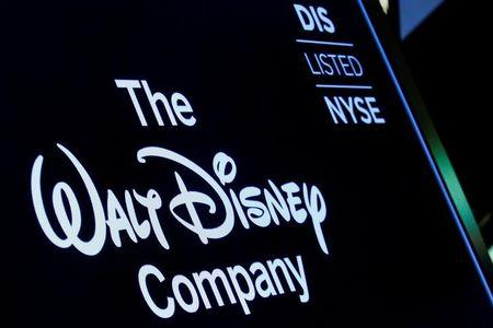 FILE PHOTO: A screen shows the logo and a ticker symbol for The Walt Disney Company on the floor of the New York Stock Exchange (NYSE) in New York, U.S., December 14, 2017. REUTERS/Brendan McDermid