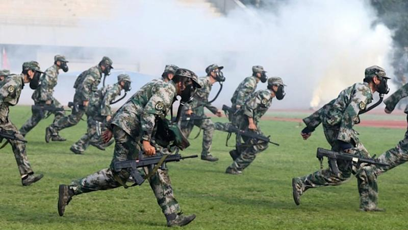 Hong Kong and Macau students will face compulsory military training at top mainland Chinese university for first time