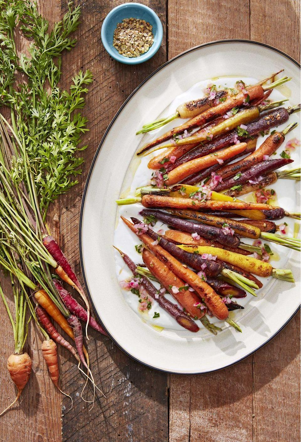 """<p>Add some color to your barbecue spread with this rainbow-hued recipe.</p><p><strong><a href=""""https://www.countryliving.com/food-drinks/a28609650/coriander-roasted-carrots-recipe/"""" rel=""""nofollow noopener"""" target=""""_blank"""" data-ylk=""""slk:Get the recipe"""" class=""""link rapid-noclick-resp"""">Get the recipe</a></strong>.</p>"""