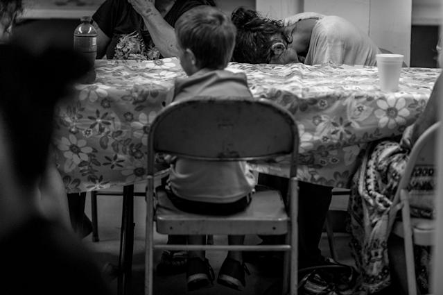 <p>Neighborhood residents attend a free Sunday breakfast and church service at La Requena Belen church in Middletown, Ohio. A young boy picks at cereal.<br> (Photograph by Mary F. Calvert for Yahoo News) </p>