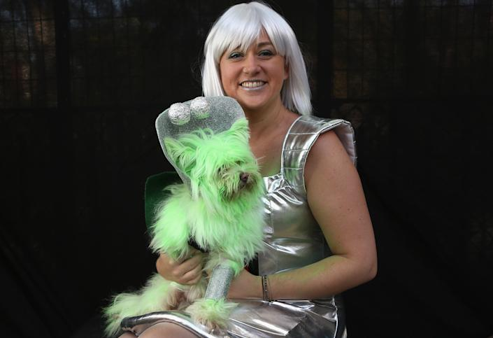 Nichole Hallberg holds her dog Wilson, a rescued mixed breed posing as a Martian, at the Tompkins Square Halloween Dog Parade. (Photo by John Moore/Getty Images)