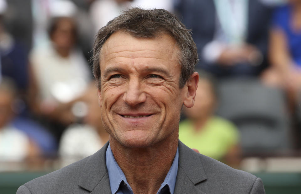 Mats Wilander (pictured) receives on court a trophy for his three titles at the French Open.