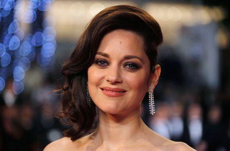 """Cast member Marion Cotillard poses on the red carpet as they arrive for the screening of the film """"Juste la fin du monde"""" (It s Only the End of the World) in competition at the 69th Cannes"""