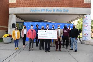 Ribbon cutting event and check presentation outside of The Asylum Hill Boys & Girls Club location commemorating Stop & Shop's $75,000 grant to the Boys  & Girls Club of Hartford funding food security and nutritional education programs.