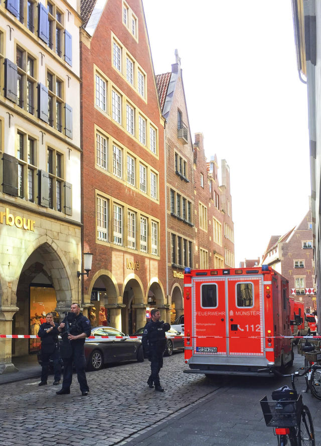 <p>Firefighters stand in downtown Muenster, Germany, Saturday, April 7, 2018. (Photo: dpa via AP) </p>