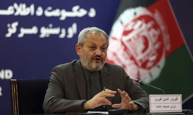 Afghanistan's minister of public health, Ferozuddin Feroz. speaks at a press conference in Kabul on 16 March.