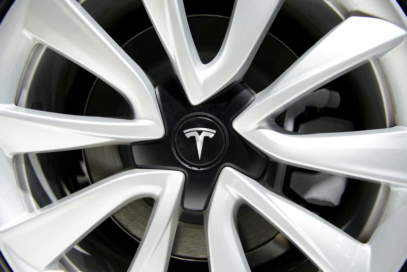 FILE PHOTO: Tesla logo is seen on a wheel rim during the media day for the Shanghai auto show in Shanghai