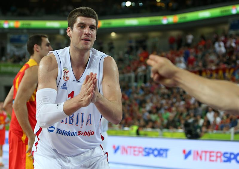 Serbia's Djordje Gagic reacts to a referee's desicion during a EuroBasket European Basketball Championship quarterfinal match against Spain at the Stozice Arena, in Ljubljana, Slovenia, Wednesday, Sept. 18, 2013. (AP Photo/Thanassis Stavrakis)