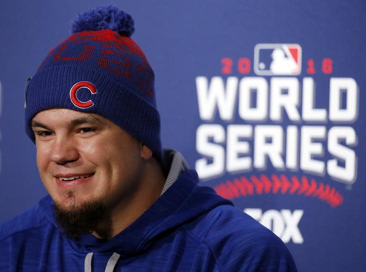 Kyle Schwarber smiles as he answers a question during a news conference for Game 3 of the MLB World Series. (AP)