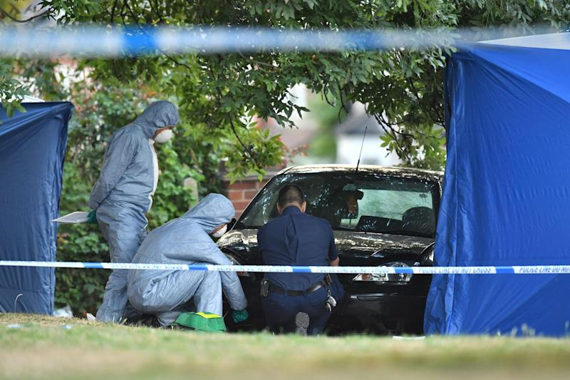 Two killed: Police at the scene after the crash: Dominic Lipinski/PA Wire