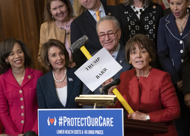 Rep. Anna Eshoo, D-Calif., right, chair of the House Health Subcommittee, says Trump and Barr want to take a sledgehammer to health care, as she joins, from left, Rep. Lisa Blunt Rochester, D-Del., Pelosi and Schumer at a Democratic event on May 15, 2019.