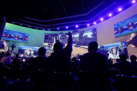 FILE PHOTO - Audience members watch an e-sports tournament during the Game XP 2018 at the Olympic Park in Rio de Janeiro
