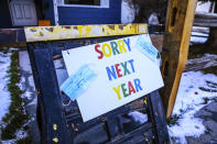 A sign indicates that residents of a house will not be handing out treats for Halloween during the coronavirus pandemic, Friday, Oct. 30, 2020, in Minturn, Colo. (AP Photo/Vail Daily via AP)