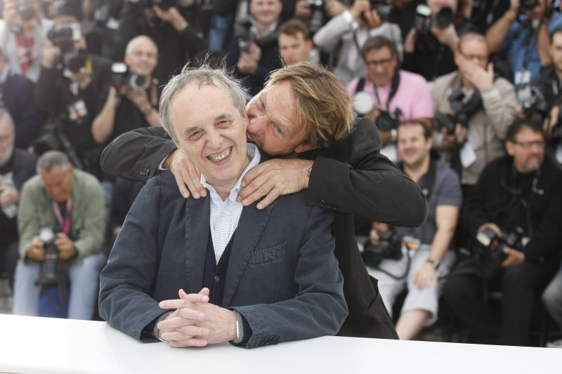 Director Dario Argento, left and actor Thomas Kretschmann interact during a photo call for Dario Argento Dracula at the 65th international film festival, in Cannes, southern France, Saturday, May 19, 2012. (AP Photo/Lionel Cironneau)