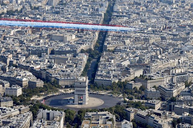 <p>The Patrouille de France Alpha Jet aircrafts fly over the Arc de Triomphe at the start of the annual Bastille Day military parade on the Champs-Élysées in Paris on July 14, 2018. (Photo: Gerard Julien/AFP/Getty Images) </p>