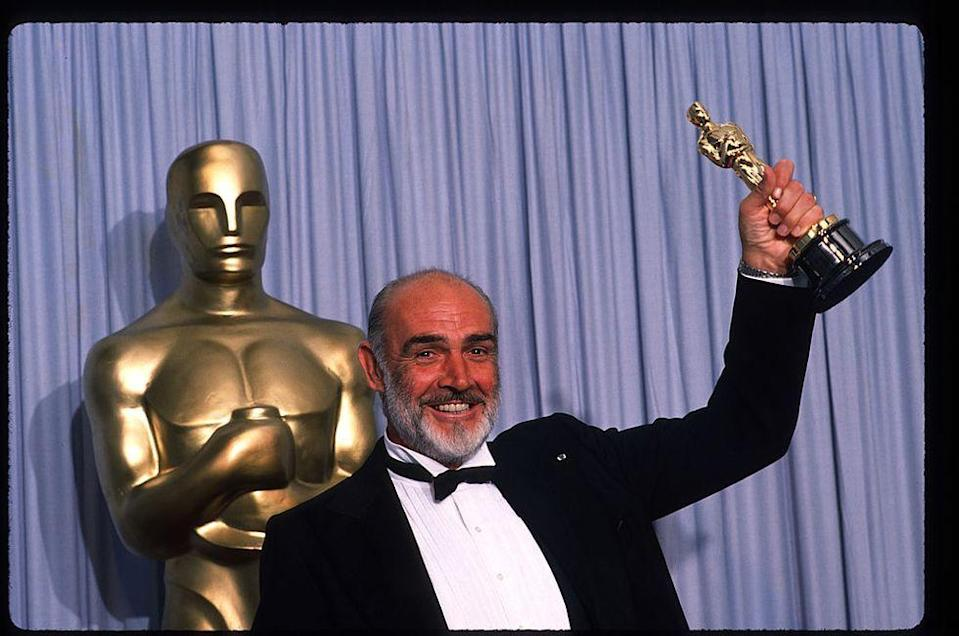 <p>Connery holds up his Best Actor in a Supporting Role Oscar for <em>The Untouchables</em> at the Academy Awards April 11, 1988</p>