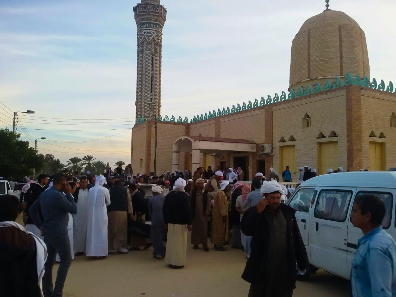<p>People gather at the site of the Egypt Sinai mosque bombing in Al-Arish, Egypt on Nov. 24, 2017. (Photo: Stringer/Anadolu Agency/Getty Images) </p>