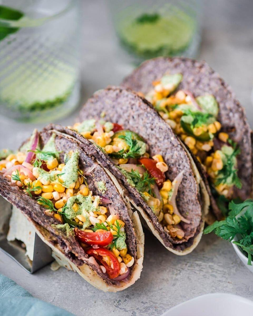 """<p>Hard taco shells don't get the love they deserve, but this recipe gives it to them. Nisha Vora, the author of this black bean and corn salad taco recipe, recommends heating your taco shells slightly to make them more pliable and prevent cracking. <br></p><p><a class=""""link rapid-noclick-resp"""" href=""""https://rainbowplantlife.com/double-decker-black-bean-and-corn-salad-tacos/#recipe"""" rel=""""nofollow noopener"""" target=""""_blank"""" data-ylk=""""slk:Get the recipe"""">Get the recipe</a></p><p>*<em>Nutritional information not available</em></p>"""
