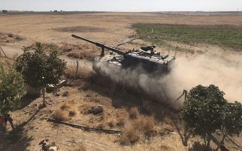 Turkish Armed Forces' howitzers deploy across Syrian town of Tal Abyad - Credit: Anadolu
