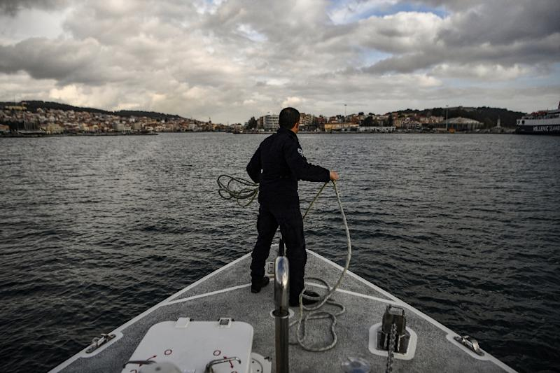 Coastal patrols see a continuing stream of arrivals, although far lower than at the peak of the crisis (AFP Photo/ARIS MESSINIS)