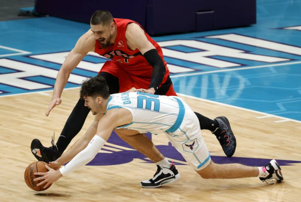 Darling grabs a loose ball during an exhibition game in December against the Raptors.