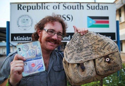 World-traveler Graham Hughes poses in his final destination, South Sudan