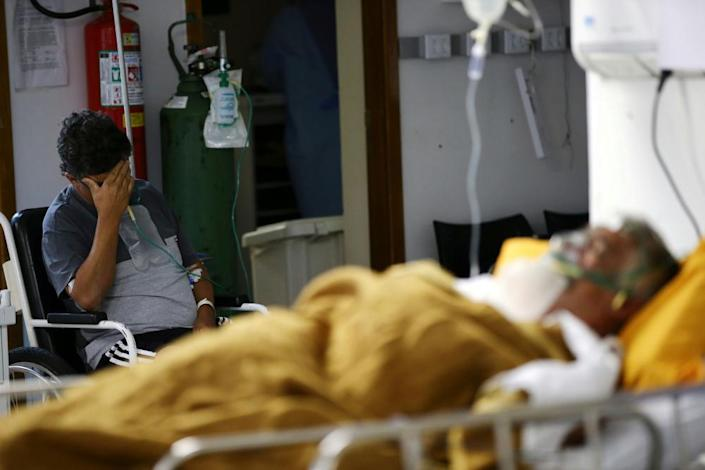 Patients in the emergency room of a hospital that is overcrowding in Porto Alegre, Brazil, on 11 March.