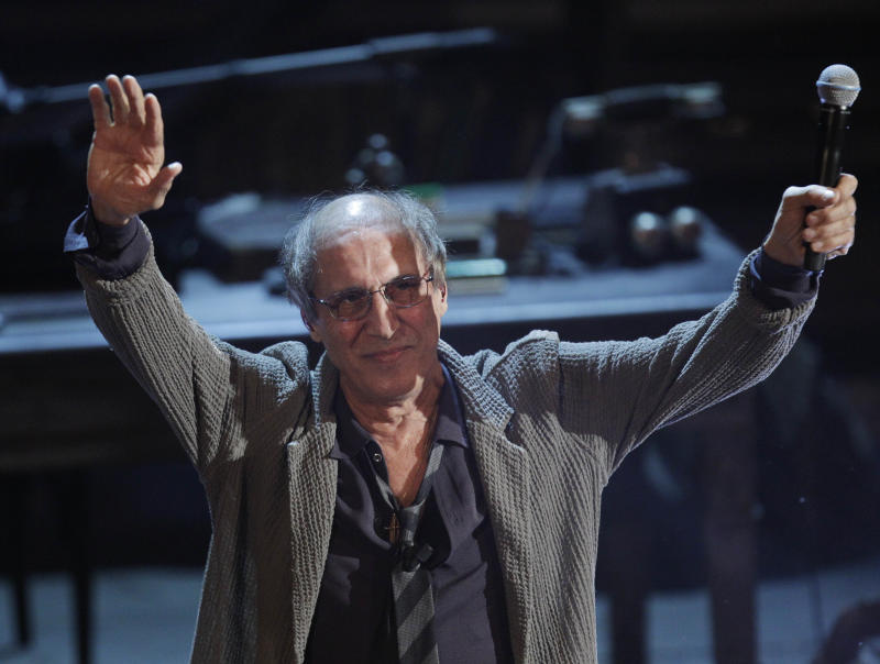 Italian singer Adriano Celentano performs during the 62nd edition of the Sanremo Song Festival, in Sanremo, Italy, Saturday, Feb. 18, 2012. (AP Photo/Luca Bruno)