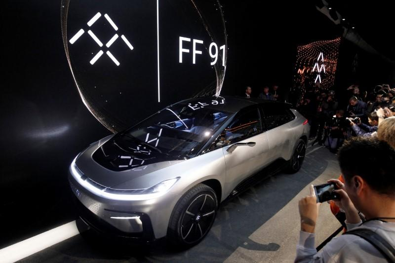 A Faraday Future FF 91 electric car is displayed on stage during an unveiling event at CES in Las Vegas