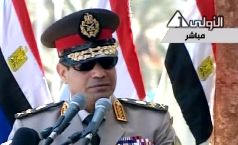 """In this image taken from Egypt State TV, Egyptian Defense Minister Gen. Abdel-Fattah el-Sissi delivers a speech in Cairo, Egypt, Wednesday, July 24, 2013. El-Sissi has called on Egyptians to hold mass demonstrations to voice their support for the military to put an end to """"violence"""" and """"terrorism.""""( AP Photo/Egypt State TV)"""