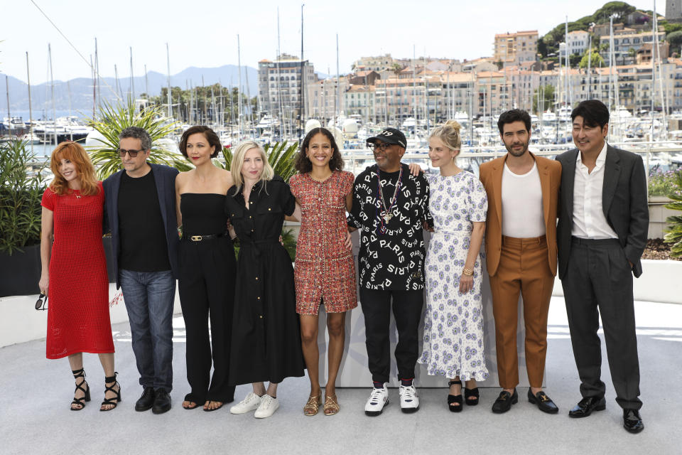 Jury president Spike Lee, fourth from right, poses with jury members Mylene Farmer, from left, Kleber Mendonca Filho, Maggie Gyllenhaal, Jessica Hausner, Mati Diop, Melanie Laurent, Tahar Rahim and Kang-Ho Song at the photo call for the jury at the 74th international film festival, Cannes, southern France, Tuesday, July 6, 2021. (Photo by Vianney Le Caer/Invision/AP)