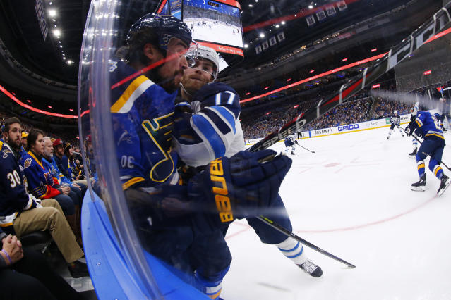 Winnipeg Jets center Adam Lowry (17) checks St. Louis Blues defenseman Justin Faulk (72) during the second period of an NHL hockey game Sunday, Dec. 29, 2019, in St. Louis. (AP Photo/Dilip Vishwanat)